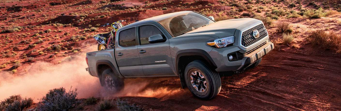 2018 Toyota Tacoma with Motorbike in Pickup Bed