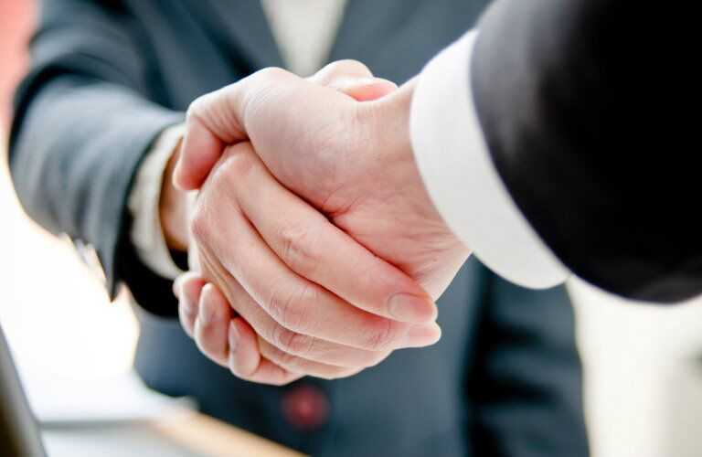 two people shaking hands on a deal