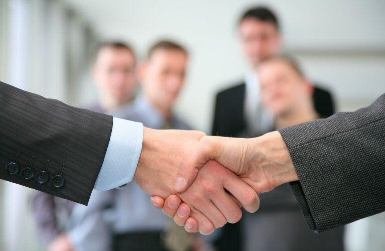 Shaking hands over a Yemm vehicle exchange