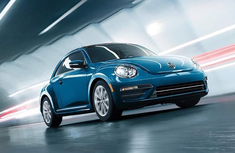 2018 Volkswagen Beetle in blue driving