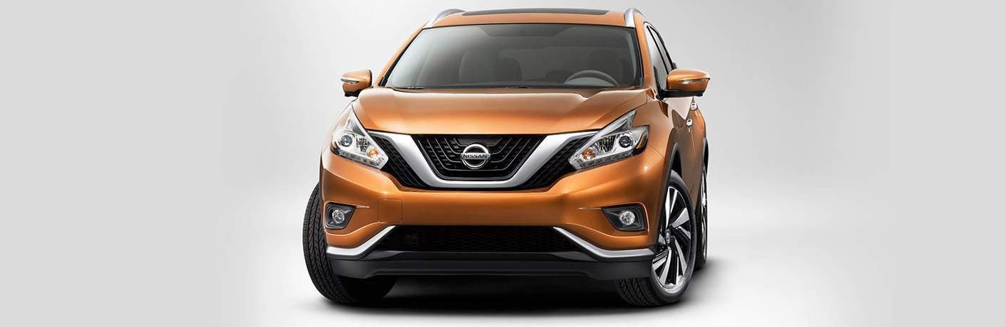 orange 2018 nissan murano against white background