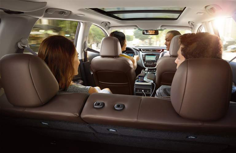 family of four in interior of 2018 nissan murano