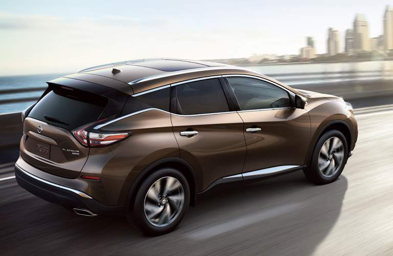 broonze 2018 nissan murano driving across bridge into large city