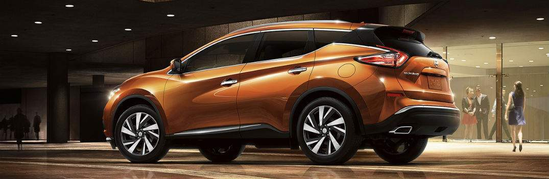 orange 2017 nissan murano parked under city lights on street