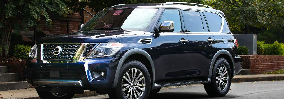 blue 2018 nissan armada parked on city street