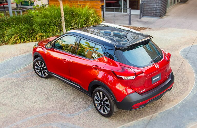 2018 Nissan Kicks exterior back fascia drivers side top view parked in front of building