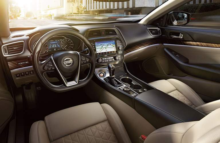 front interior of 2018 nissan maxima including tan seats, steering wheel and dashboard