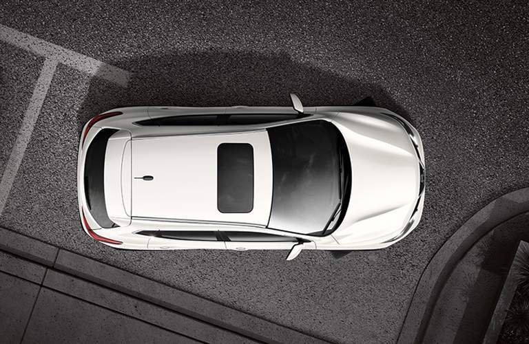 aerial view of white 2018 nissan rogue sport parallel parking