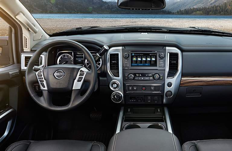 front interior of 2018 nissan titan including steering wheel and infotainment system