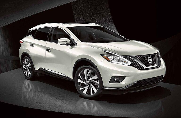 white Nissan Murano on a pedestal