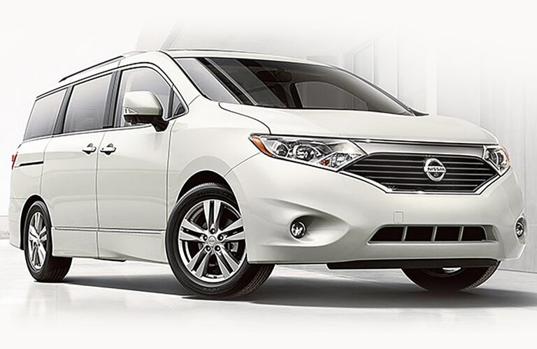 white Nissan Quest in front of white background