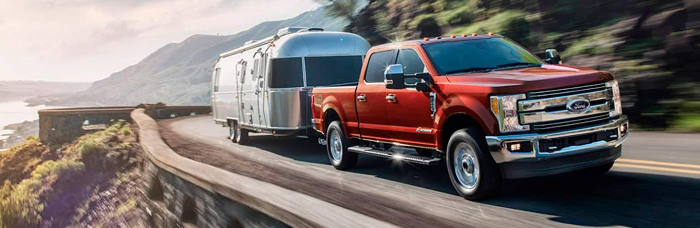 2017 Ford F-350 Driving along the sea while towing a trailer