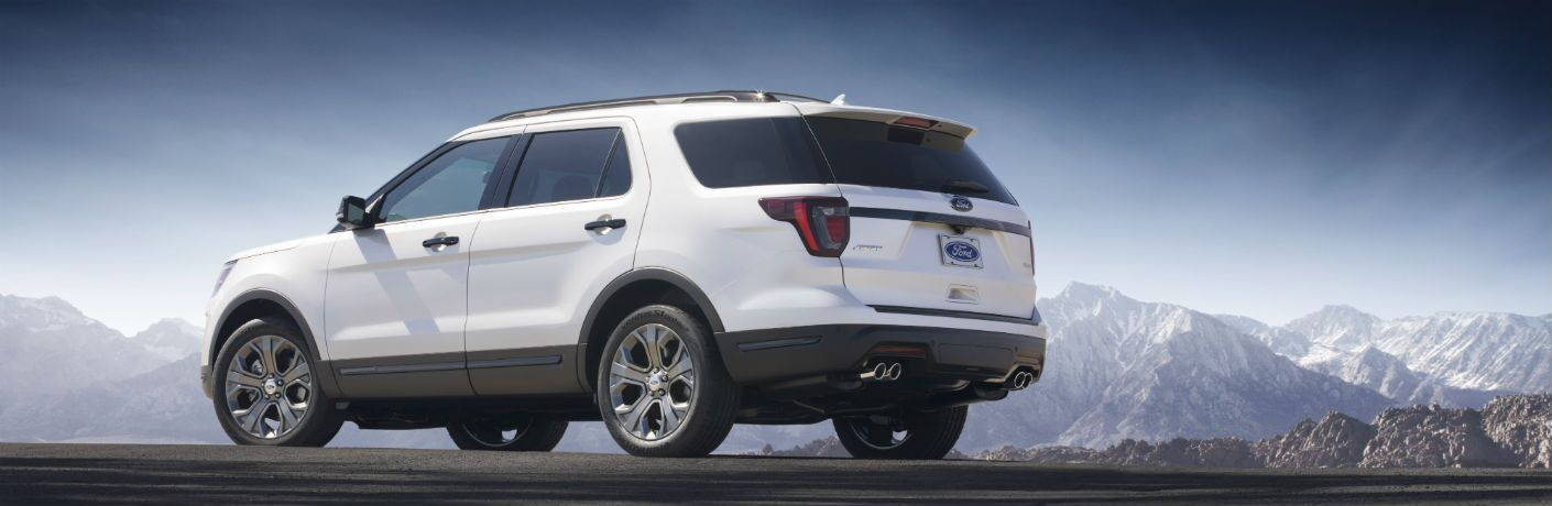 side view of a white 2018 Ford Explorer with mountains in the background