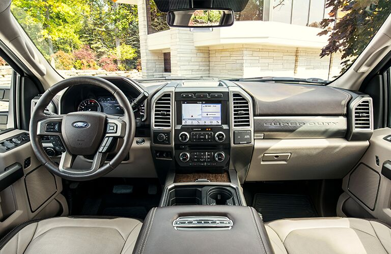Interior front cabin, dashboard, steering wheel, infotainment, and windshield view of a 2019 Ford F-250.