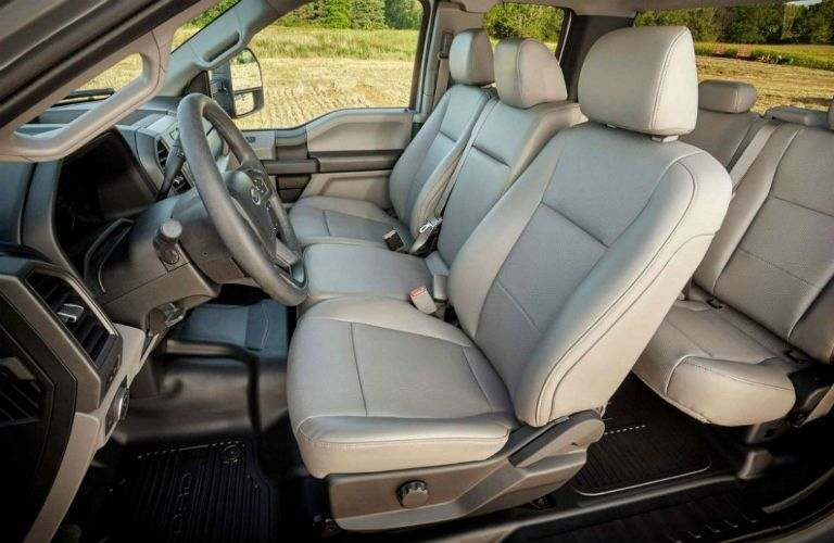 Side view of the interior front and rear seats of the 2019 Ford F-350.