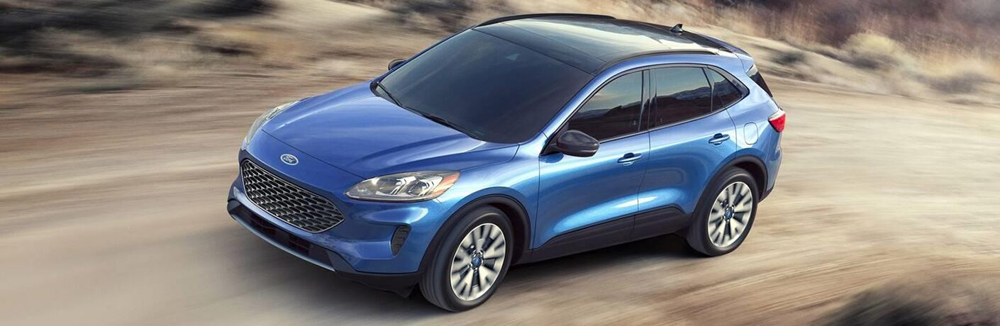 2020 Ford Escape from exterior front drivers side driving down dirt road