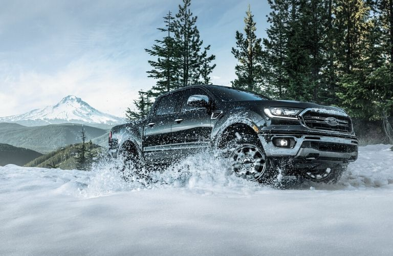 2020 Ford Ranger driving through snow from exterior passenger side