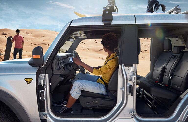 Woman sitting in 2021 Ford Bronco with doors off