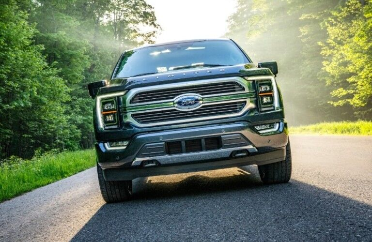 A 2021 Ford F-150 driving on a road