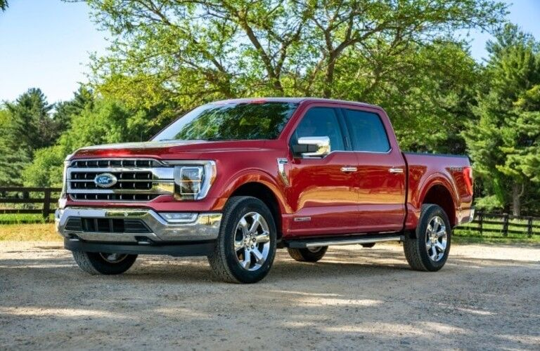A red-colored 2021 Ford F-150 parked outside