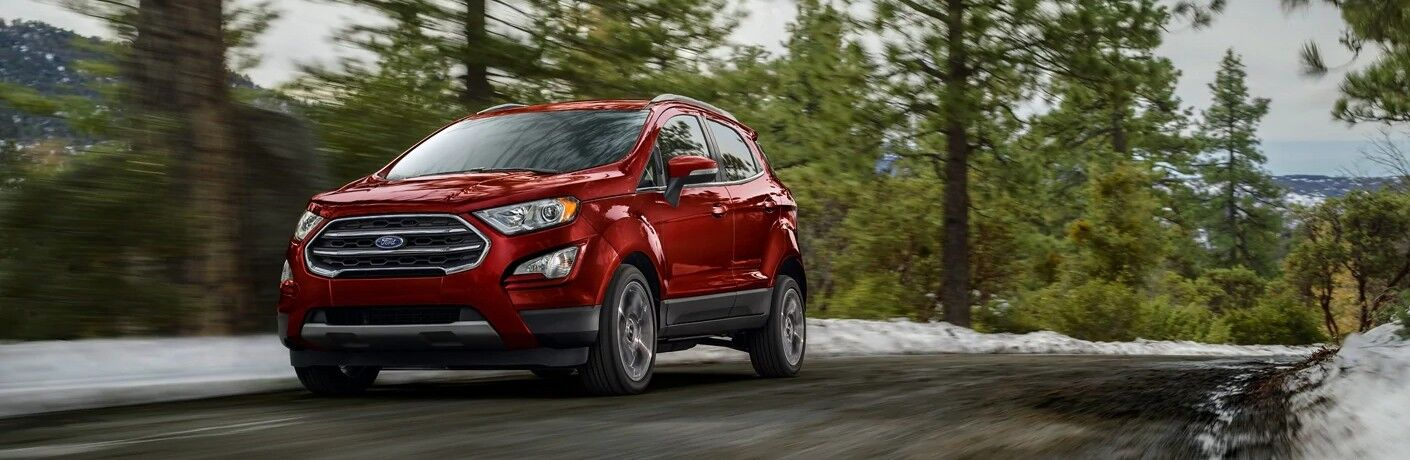 2021 Ford EcoSport driving on road with trees