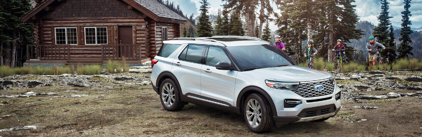 2021 Ford Explorer in front of cabin and family