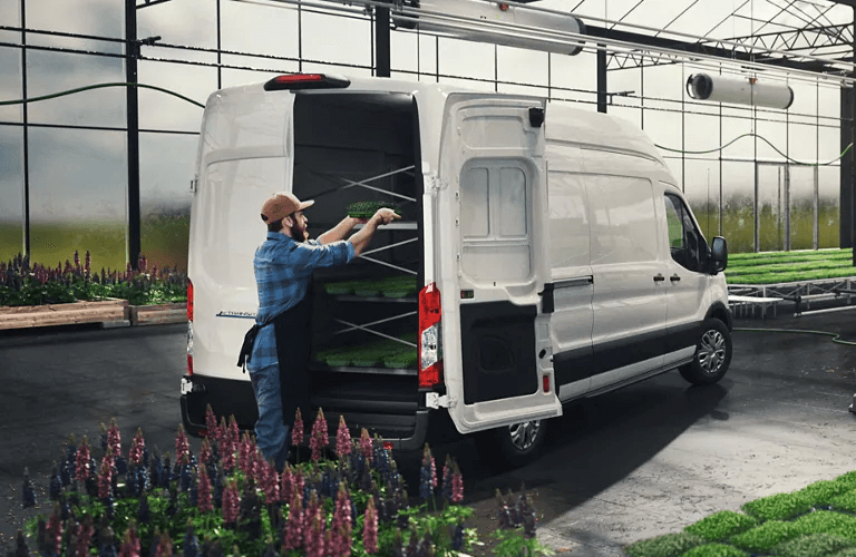 Man loading flowers into 2022 Ford E-Transit