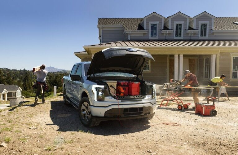 Construction working on house out of 2022 Ford F-150 Lightning