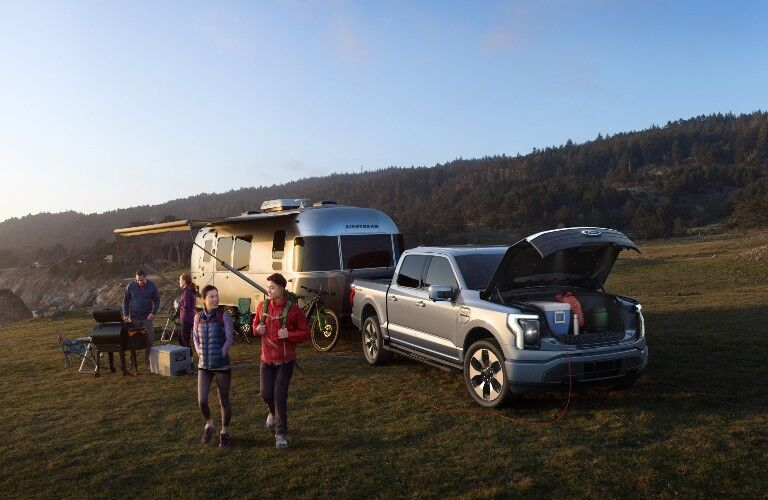 Family camping with 2022 Ford F-150 Lightning