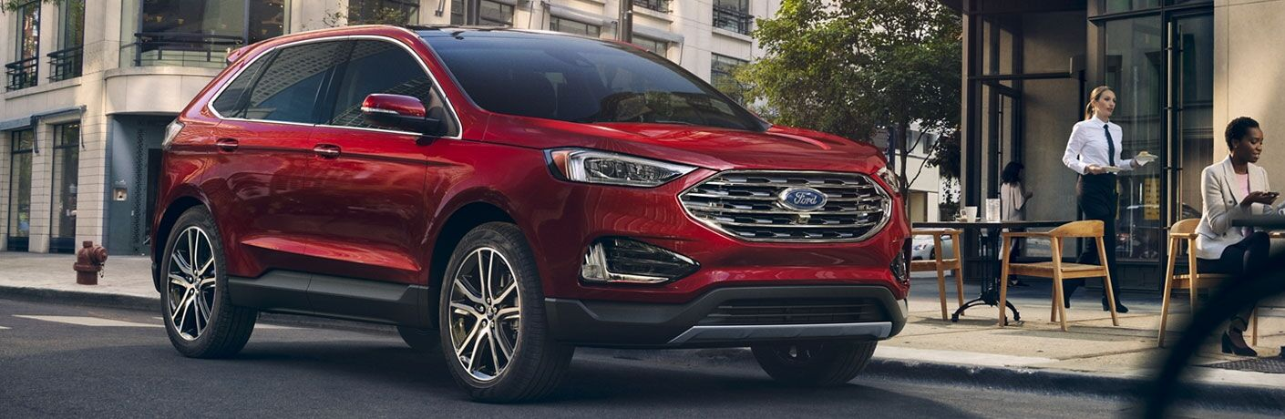 Red 2020 Ford Edge parked on road from exterior front and passenger side