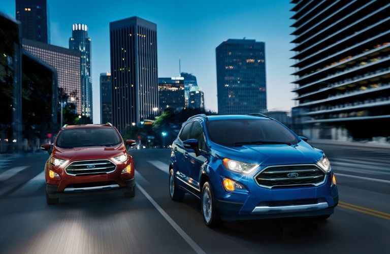 Two 2020 Ford EcoSports driving in city