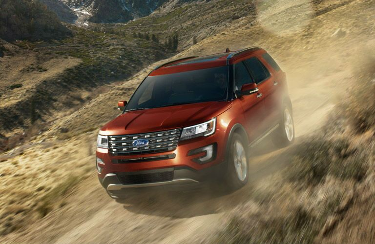 Red 2016 Ford Explorer on dirt road