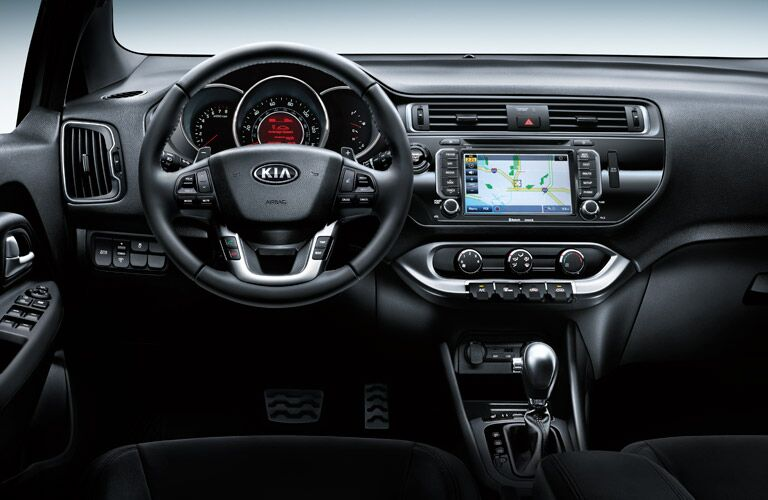 2016 Kia Rio 5-Door vs. 2016 Honda Fit compact cargo room handling 33.5-foot turning circle fuel economy Friendly Kia of New Port Richey Tampa Clearwater St. Petersburg Spring Hill FL