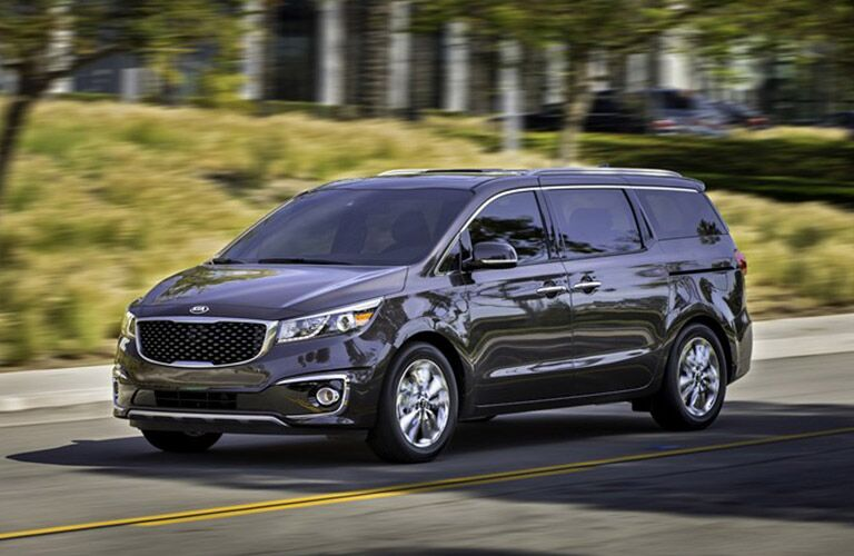 2018 kia sedona from the front driving