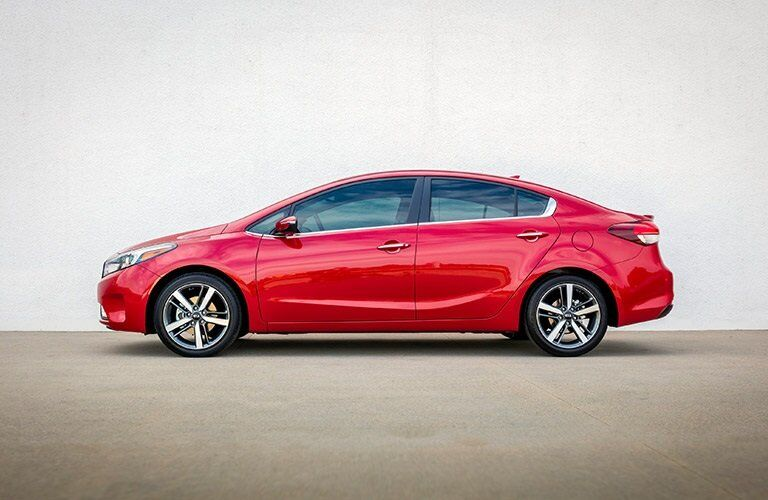 2017 and 2018 kia forte profile view in red against white wall
