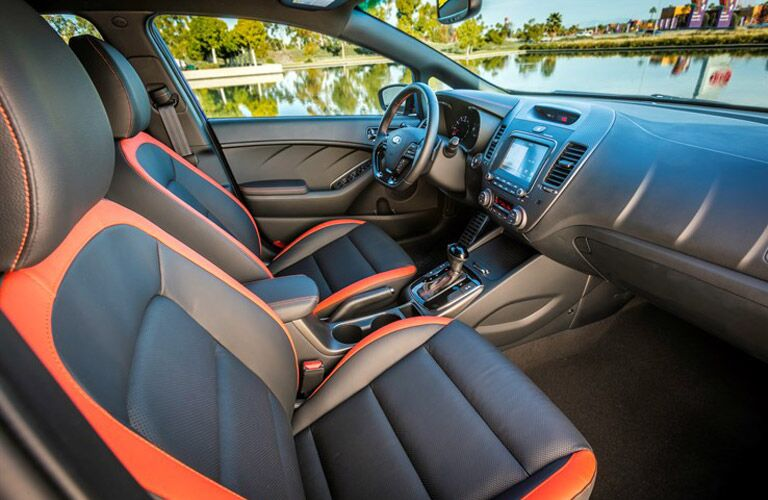 2018 kia forte5 interior featuring steering wheel and infotainment with orange trim