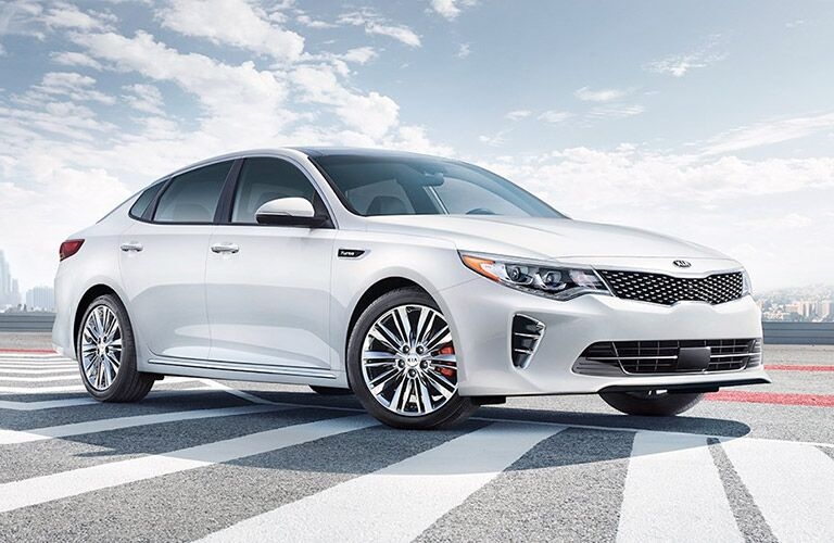 2017 kia optima in white on tarmac at airport
