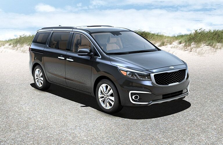 red 2017 kia sedona on beach