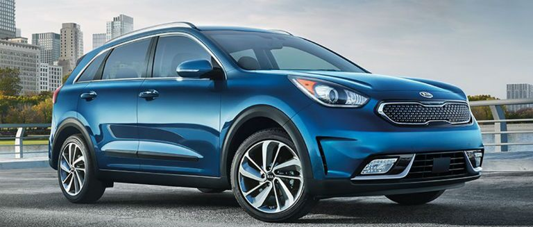 2018 kia niro in dark blue parked front three quarter passenger