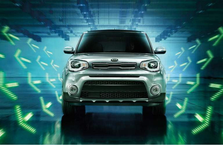 stylized photo of the 2018 kia soul with green arrows emanating