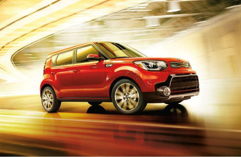 2018 kia soul against stylized orange wind tunnel style background