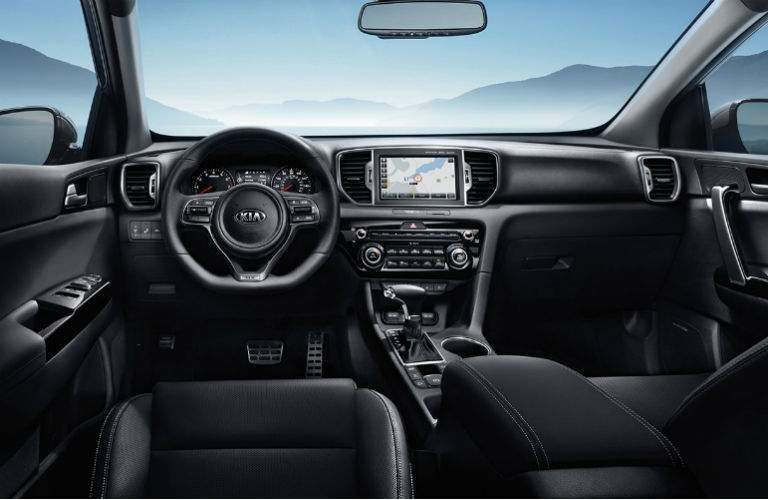 interior of 2018 kia sportage sx with navigation and racing steering wheel