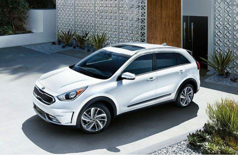 2018 kia niro in white parked in front of home