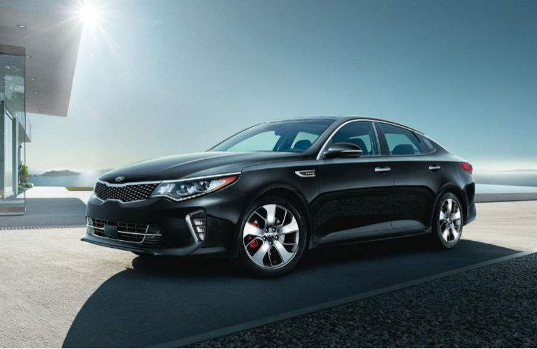 2018 kia optima in black on driveway