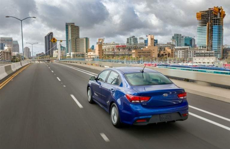 2018 kia rio in blue driving on highway