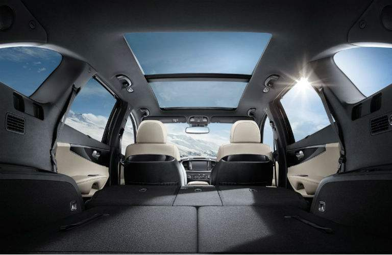 interior of 2018 kia sorento shown from rear liftgate with sunroof and folded down seats