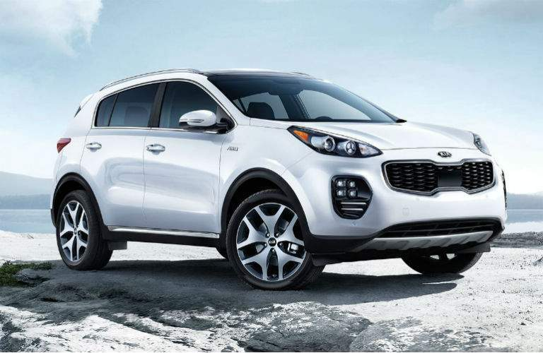 2018 kia sportage sx in white perched atop snowy mountain