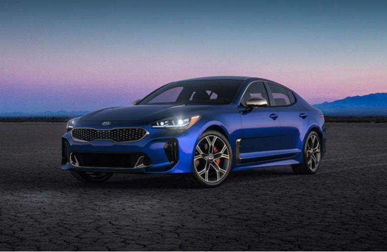 2018 kia stinger gt in blue parked on flat ground