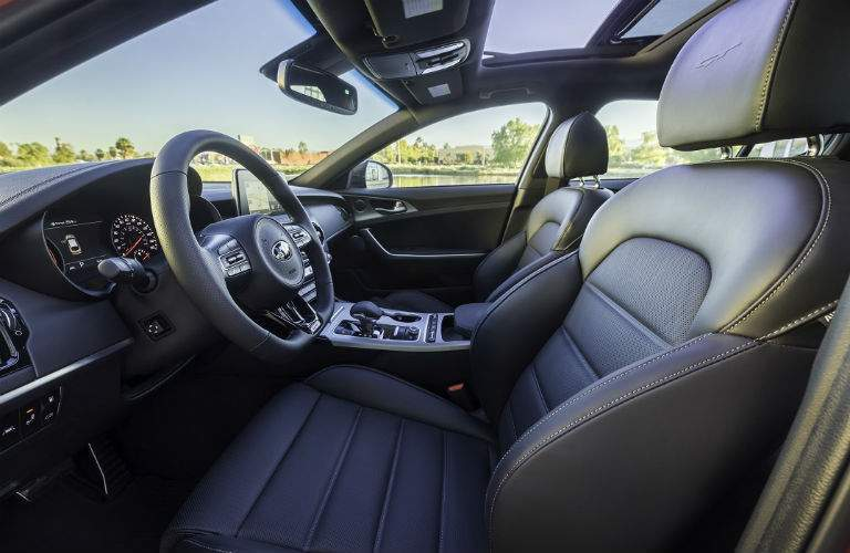 Interior of 2018 kia stinger shows headroom and steering wheel with front seats in gt trim