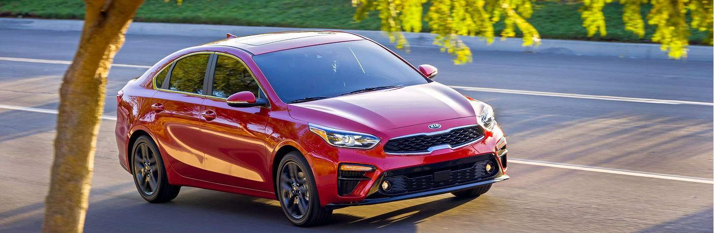 2019 kia forte in red driving on road near tampa florida